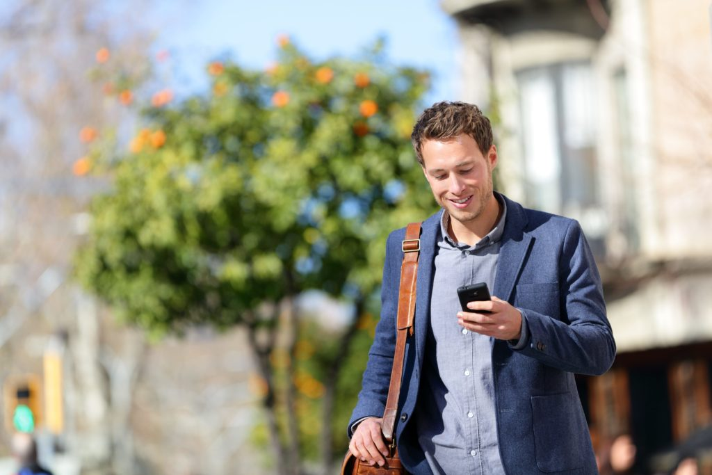 Young businessman texting